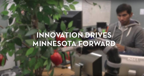 "blurred image of a student conducting research, ""Innovation drives Minnesota forward"""